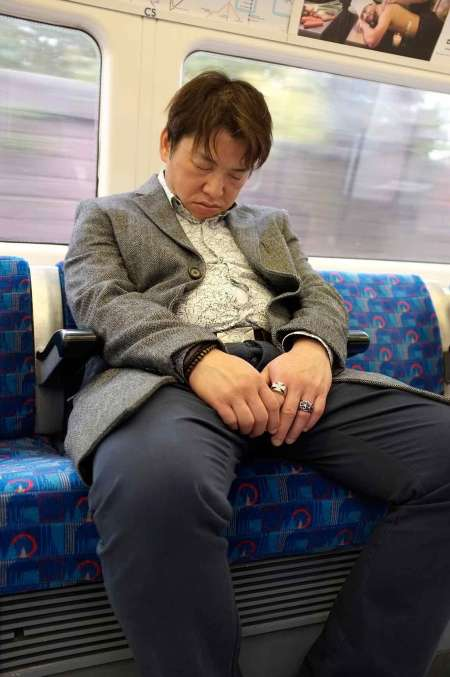 sleeping-man-on-tube
